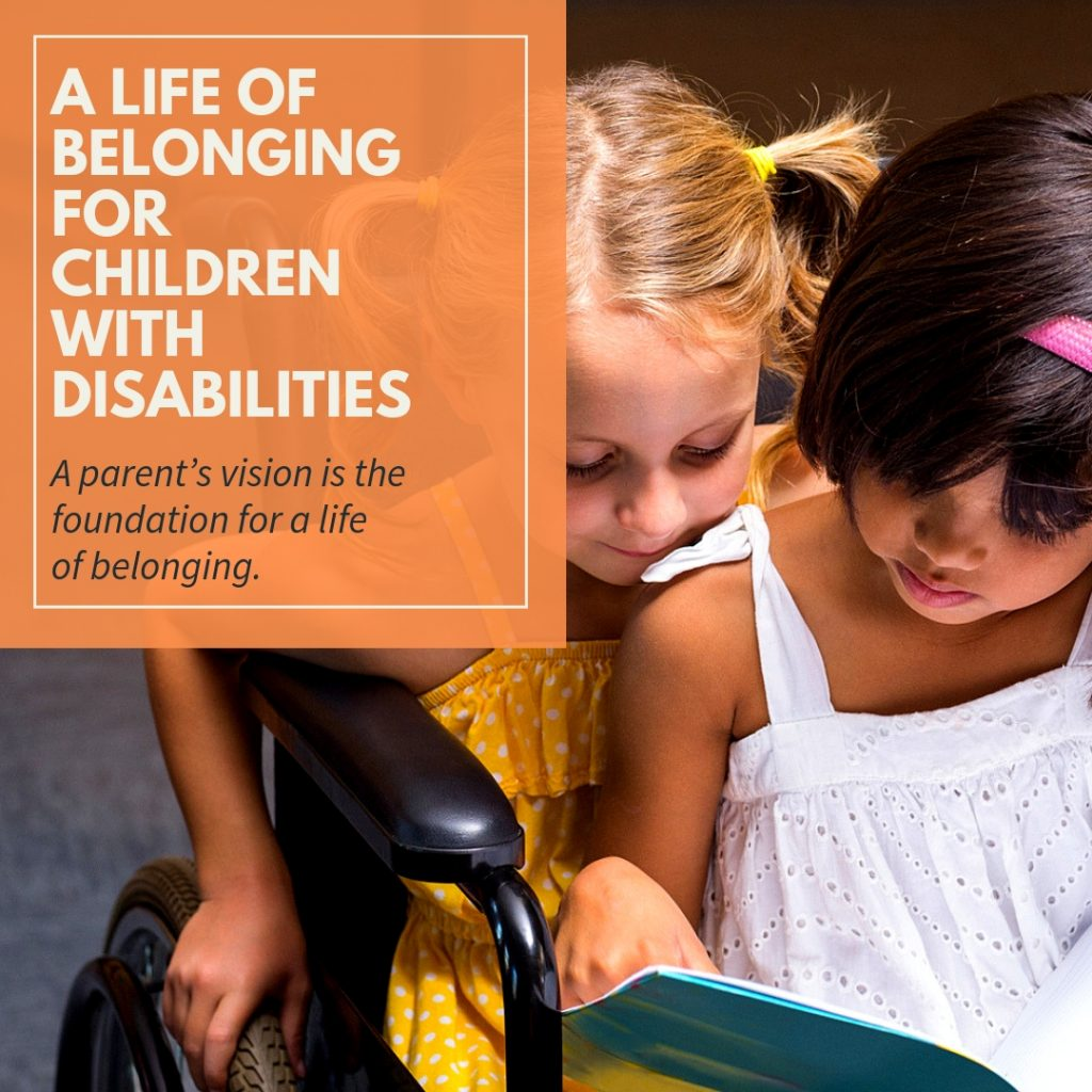 Two children reading together. One child sitting in her wheelchair and her friend sitting on her lap.